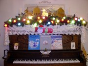 Christmas decorations on top of a piano