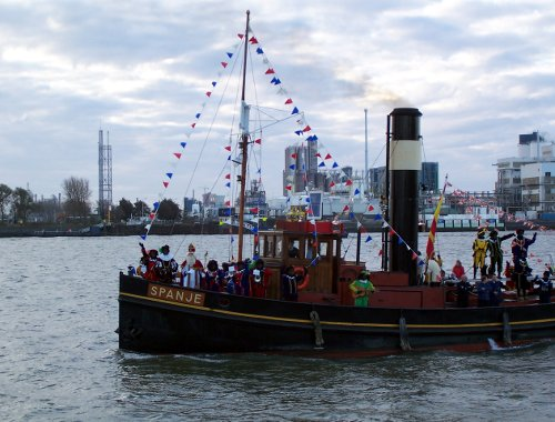 Sinterklaas and Zwarte Pieten arriving by steamboat in Vlaardingen (The Netherlands) in November 2006